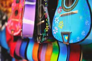blue purple and green acoustic guitars