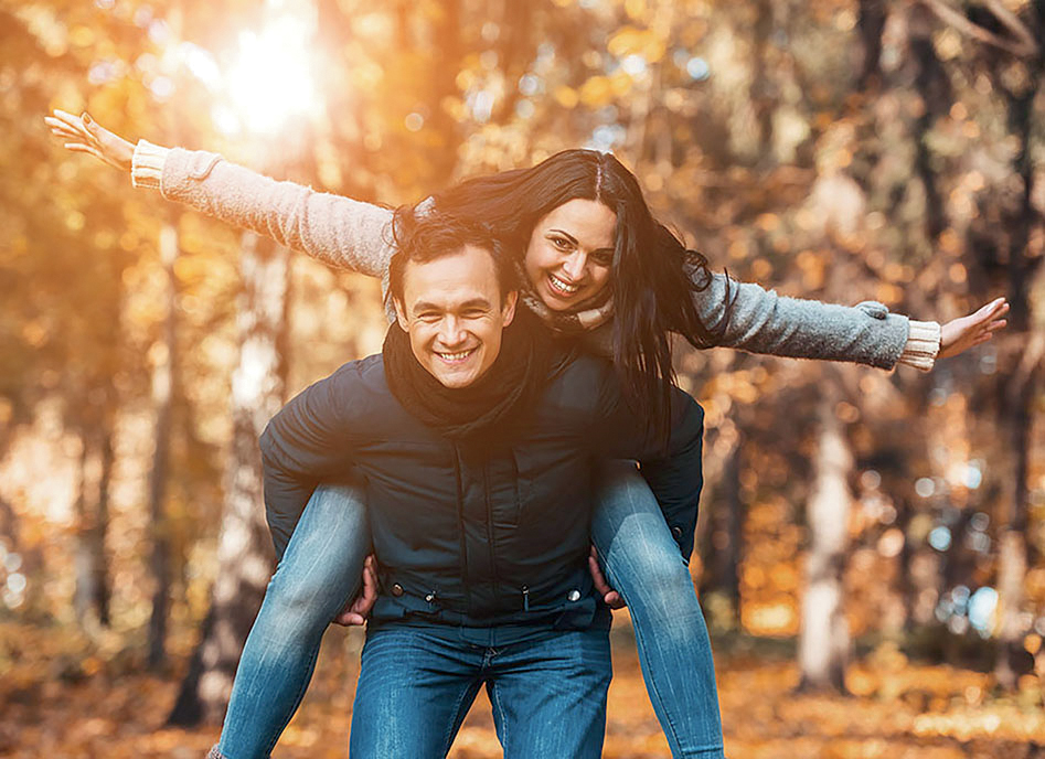 Young Happy Couple Have Fun In Park In Autumn. Happy Time Spendi