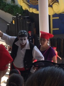Pirate mime trying to help guests find seats