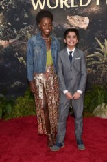 """HOLLYWOOD, CALIFORNIA - APRIL 04: Actors Lupita Nyong'o and Neel Sethi attend The World Premiere of Disney's """"THE JUNGLE BOOK"""" at the El Capitan Theatre on April 4, 2016 in Hollywood, California. (Photo by Alberto E. Rodriguez/Getty Images for Disney) *** Local Caption *** Lupita Nyong'o; Neel Sethi"""