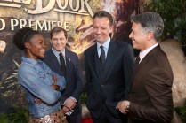 """HOLLYWOOD, CALIFORNIA - APRIL 04: (L-R) Actress Lupita Nyong'o, EVP Production, The Walt Disney Company, Sam Dickerman, President of Walt Disney Studios Motion Picture Production, Sean Bailey and President of Marketing for The Walt Disney Studios, Ricky Strauss attend The World Premiere of Disney's """"THE JUNGLE BOOK"""" at the El Capitan Theatre on April 4, 2016 in Hollywood, California. (Photo by Jesse Grant/Getty Images for Disney) *** Local Caption *** Sam Dickerman; Sean Bailey; Ricky Strauss; Lupita Nyong'o"""