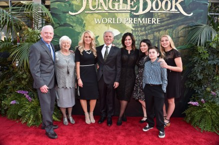 """HOLLYWOOD, CALIFORNIA - APRIL 04: Producer Brigham Taylor (C) and family attend The World Premiere of Disney's """"THE JUNGLE BOOK"""" at the El Capitan Theatre on April 4, 2016 in Hollywood, California. (Photo by Alberto E. Rodriguez/Getty Images for Disney) *** Local Caption *** Brigham Taylor"""