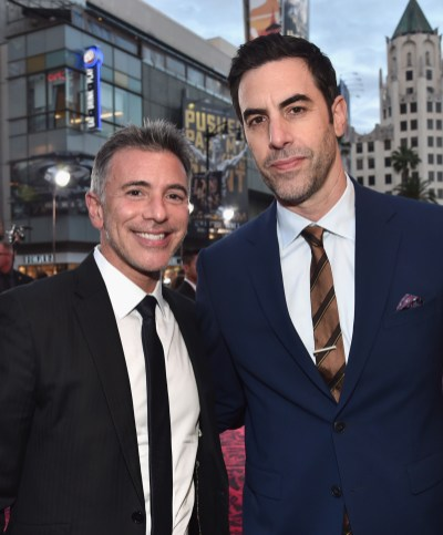 HOLLYWOOD, CA - MAY 23: President of Marketing for The Walt Disney Studios Ricky Strauss (L) and actor Sacha Baron Cohen attend Disney's 'Alice Through the Looking Glass' premiere with the cast of the film, which included Johnny Depp, Anne Hathaway, Mia Wasikowska and Sacha Baron Cohen at the El Capitan Theatre on May 23, 2016 in Hollywood, California. (Photo by Alberto E. Rodriguez/Getty Images for Disney) *** Local Caption *** Ricky Strauss; Sacha Baron Cohen