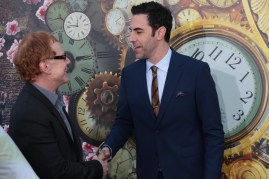 """Danny Elfman and Sacha Baron Cohen greet at The US Premiere of Disney's """"Alice Through the Looking Glass"""" at the El Capitan Theater in Los Angeles, CA on Monday, May 23, 2016. .(Photo: Alex J. Berliner/ABImages)"""