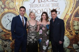 """Sacha Baron Cohen, Mia Wasikowska, Anne Hathaway and Johnny Depp pose together at The US Premiere of Disney's """"Alice Through the Looking Glass"""" at the El Capitan Theater in Los Angeles, CA on Monday, May 23, 2016. .(Photo: Alex J. Berliner/ABImages)"""