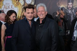 """Johnny Depp and Joe Roth pose together at The US Premiere of Disney's """"Alice Through the Looking Glass"""" at the El Capitan Theater in Los Angeles, CA on Monday, May 23, 2016. .(Photo: Alex J. Berliner/ABImages)"""