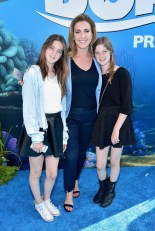 HOLLYWOOD, CA - JUNE 08: Actress Peri Gilpin (C) and guests attend The World Premiere of Disney-Pixar's FINDING DORY on Wednesday, June 8, 2016 in Hollywood, California. (Photo by Alberto E. Rodriguez/Getty Images for Disney) *** Local Caption *** Peri Gilpin