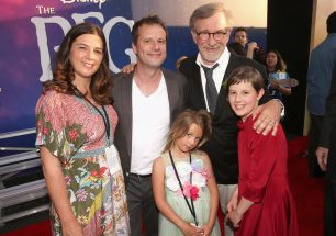 """HOLLYWOOD, CA - JUNE 21: Director Steven Spielberg (2nd R), actress Ruby Barnhill and family arrive on the red carpet for the US premiere of Disney's """"The BFG,"""" directed and produced by Steven Spielberg. A giant sized crowd lined the streets of Hollywood Boulevard to see stars arrive at the El Capitan Theatre. """"The BFG"""" opens in U.S. theaters on July 1, 2016, the year that marks the 100th anniversary of Dahl's birth, at the El Capitan Theatre on June 21, 2016 in Hollywood, California. (Photo by Jesse Grant/Getty Images for Disney) *** Local Caption *** Steven Spielberg; Ruby Barnhill"""