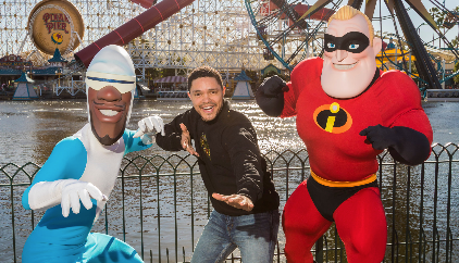 Trevor Noah strikes a pose with Mr. Incredible and Frozone at Disney California Adventure Park