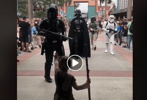 Little girl defends Star Wars Launch Bay from Darth Vader and Company