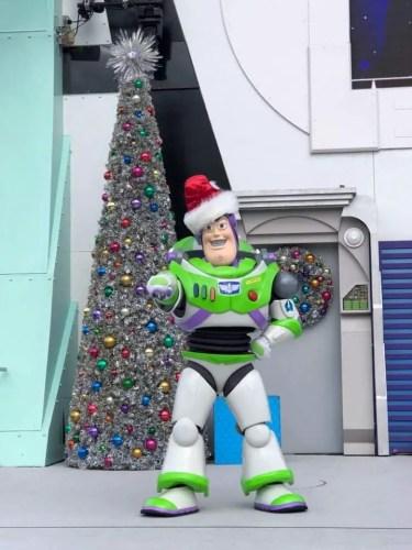 Jingle Buzz greeting guests in Tomorrowland in the Magic Kingdom 1