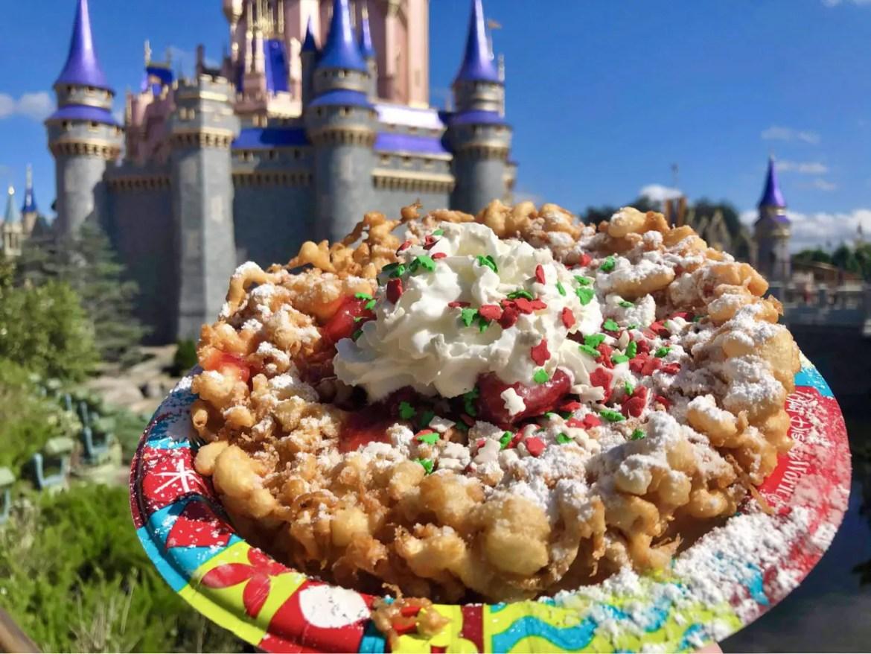 Fa La La La Funnel Cake wowing guests at the Magic Kingdom
