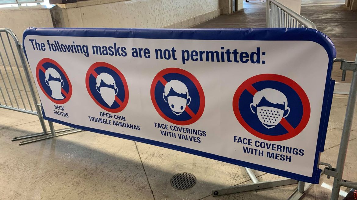 New sign shows which masks not permitted at Disney Springs
