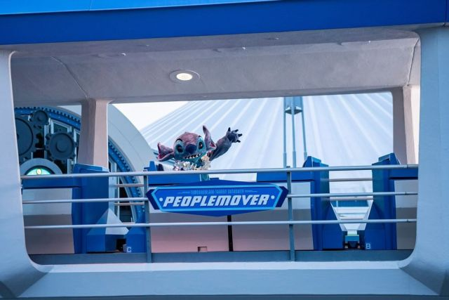 Stitch Takes a ride on the Tomorrowland Transit Authority PeopleMover 1