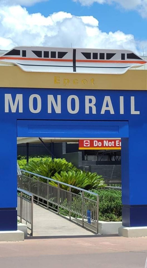 Disney Cast Members celebrate the reopening of the Epcot Monorail Line 4
