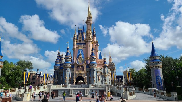Guest climbs Cinderella Castle in the Magic Kingdom for a photo 3