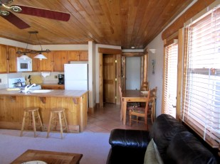 Honeymoon to Colorado 204 Two Bedroom An organized kitchen with breakfast nook and dining area on the side