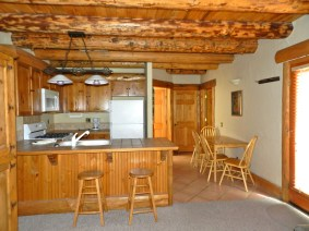 302 One Bedroom A lovely kitchen space with a cute breakfast nook