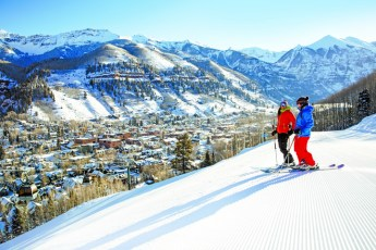 Two girls skiing with a city view Romance in the San Juan Mountians,