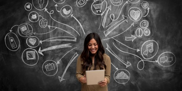 Girl on tablet with social media icon chalkboard