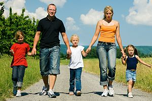 Family walking a dirtroad