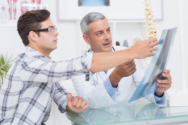 Accident Chiropractor reviewing X-rays with a patient.