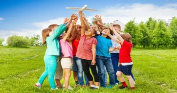 blog picture of children playing with toy plane