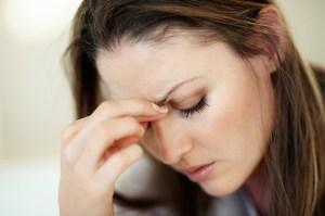 mom with headache and migraine