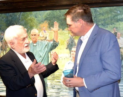 Bosque Museum Director Dr. Matt Taylor chats with antique fire arms expert David Jackson after his lecture Sunday, March 8.