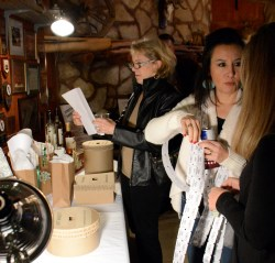 Guests Carol Linn and Renee Kettler contemplate which item their stretch raffle tickets should go to during the 50th Annual Clifton Chamber Banquet Saturday.