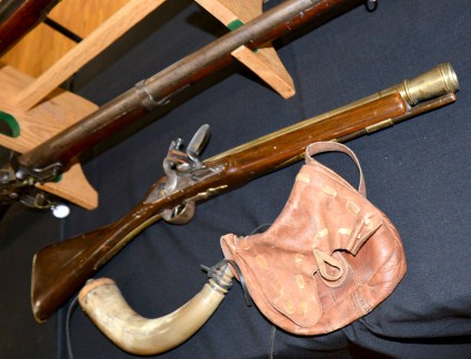 "A ""blunderbuss"" with a gunpowder horn and a pouch used for other accessories."