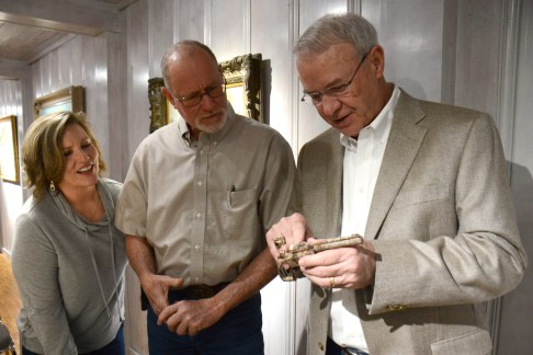 Paul Hardcastle and his wife Pam discuss an interesting find from their pasture – a .32 revolver, loaded - with gun collector Charles Lummus at the Bosque Museum Sunday March 8. In its rusted state it was difficult to determine whether it was a Smith & Wesson or a Harrington & Richardson, probably from the period between 1920-35.