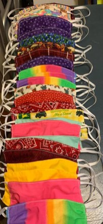 Medical face masks made by the BAC Quilt Guild come in an array of colors.