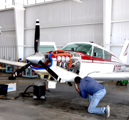 Clifton Aero Mechanic Rod Allen works on a plane at the Clifton Municipal Airport.