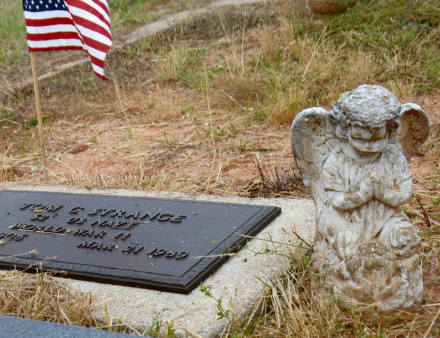 Serviceman's graves decorated with flags for Memorial Day 2020