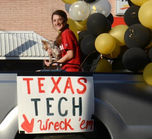 Meridian High School Senior Madisyn Hicks participates in a celebratory convoy down Main Street June 4.