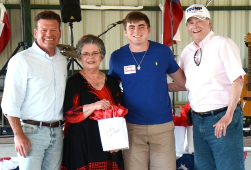 Texas Representative DeWayne Burns, Sue Fielden and Texas Senator Brian Birdwell present Colby Caniford with a $1,000 academic scholarship.