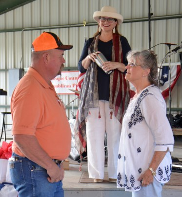 Bosque County Commissioner Pct. 4 Ronny Liardon, Bosque County Treasurer Carla Sigler and Singer Miriam Wallace visit at the Bosque County Republican Club Party in the Park event June 16.
