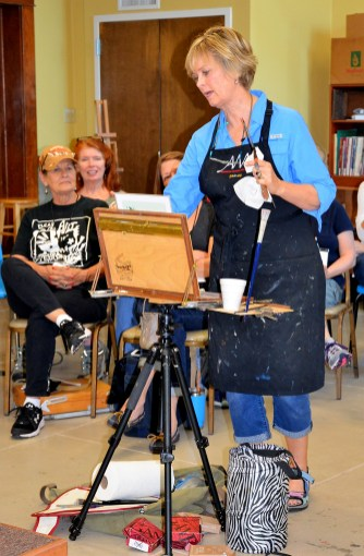 Nancy Boren addresses her eager students during a workshop at the Bosque Arts Center.