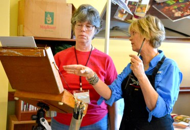 Nancy Boren instructs a student during a workshop at the Bosque Arts Center.