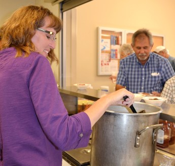 Former Meridian Public Library Board Member Kristy Bowers ladles out chili at the patron appreciation Meridian Public Library Fall Chili supper.