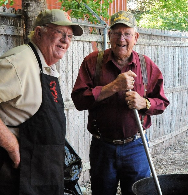 Chili Gang members Don McMahon and Ray Miller stir the pot of chili for the Meridian Public Library Fall Chili Supper.