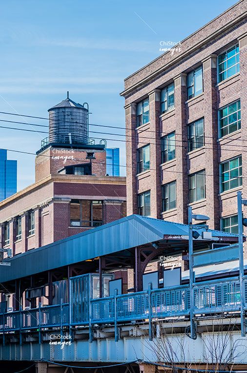 CTA L Station with Old Water Tower on a Mid-Rise Office Loft Building in Near North Side Chicago