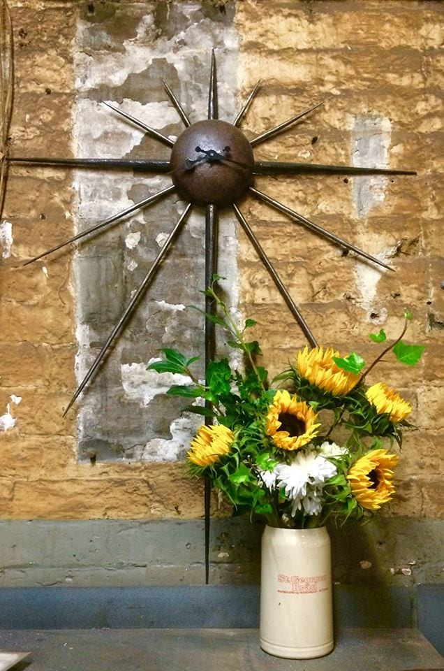 Clock and Sunflowers by Neil Brown