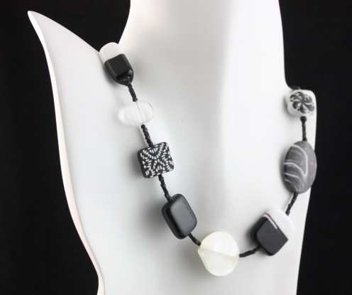 Necklace made with glass, polymer clay, ceramic and shell by Felicity Gail
