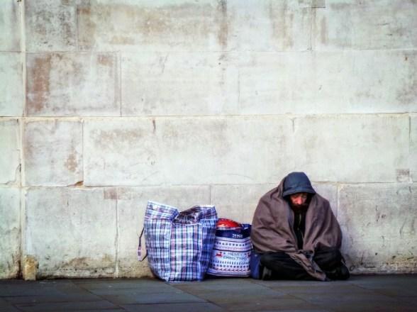 homeless man against wall st mungos