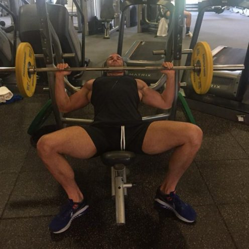 Aleksandar Dzeletovic personal trainer performing barbell incline bench press