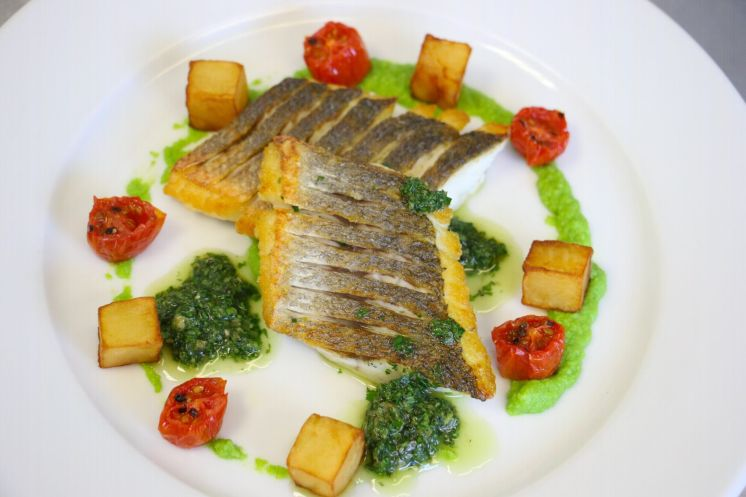 Sea bass with confit potatoes tomatoes and salsa verde_web