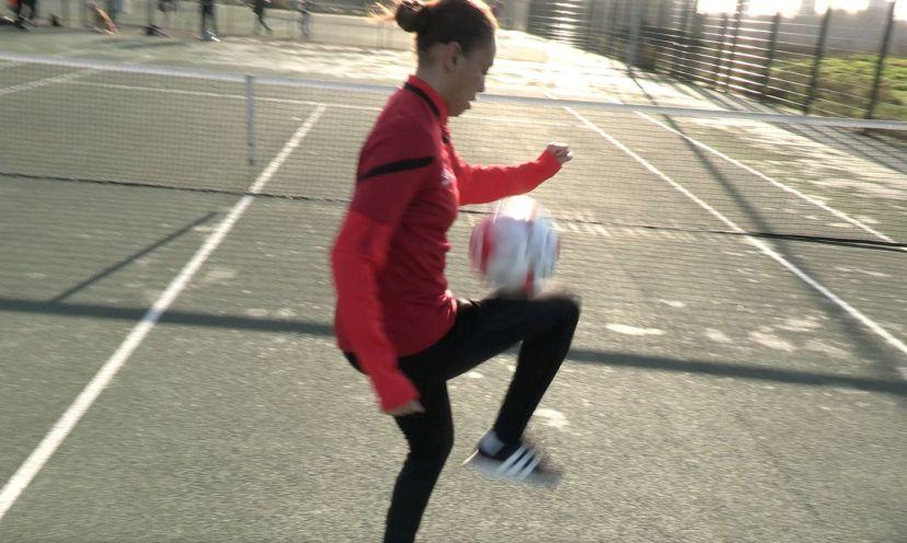 Rebekah juggling ball near net_web