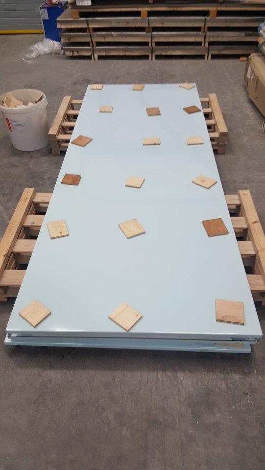 Chiswick Timeline base blue panels on pallets